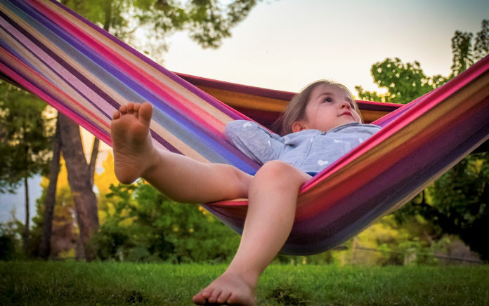 How to entertain children during vacation time girl in hammock summer