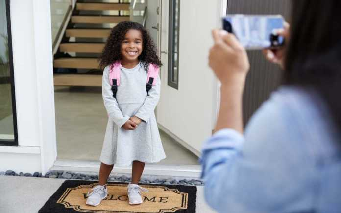 first day of school girl getting her photo taken