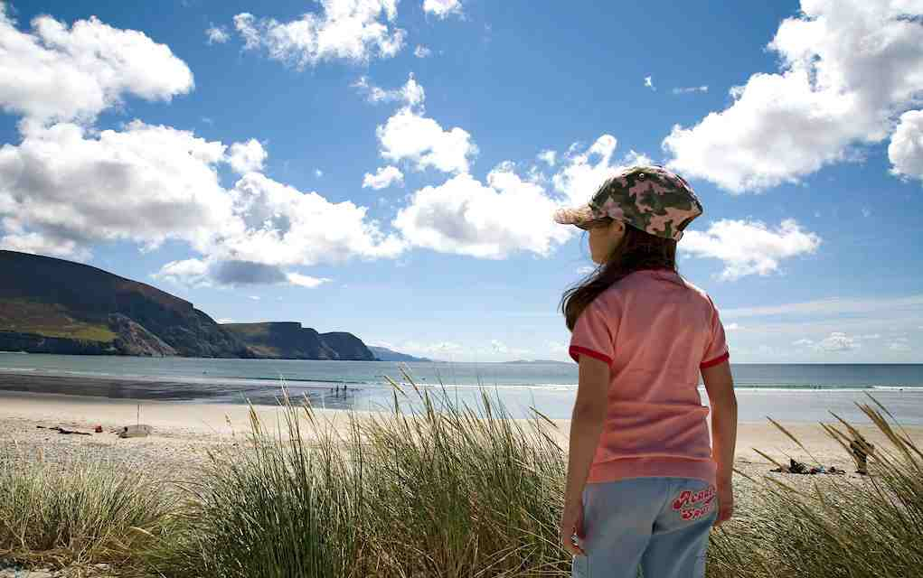 Little girl at the beach on Achill Island for places to visit in Ireland