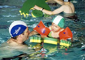 A young child learns to swim in Westport Leisure Park