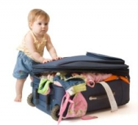 baby and suitcase